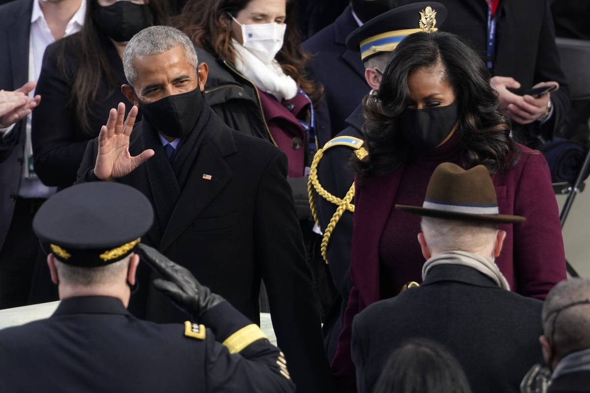 Former President Barack Obama and his wife Michelle arrive for the 59th Presidential Inaugurati ...
