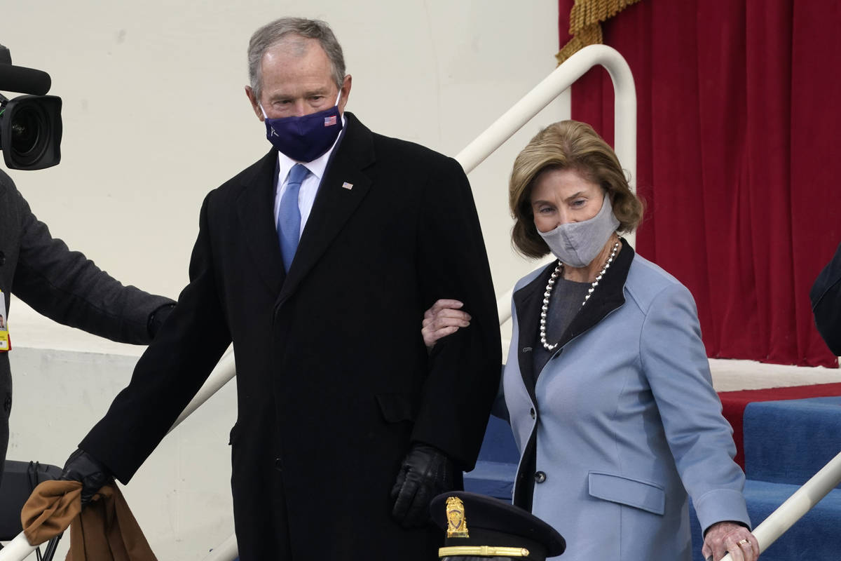 Former President George W. Bush and his wife Laura arrive for the 59th Presidential Inauguratio ...