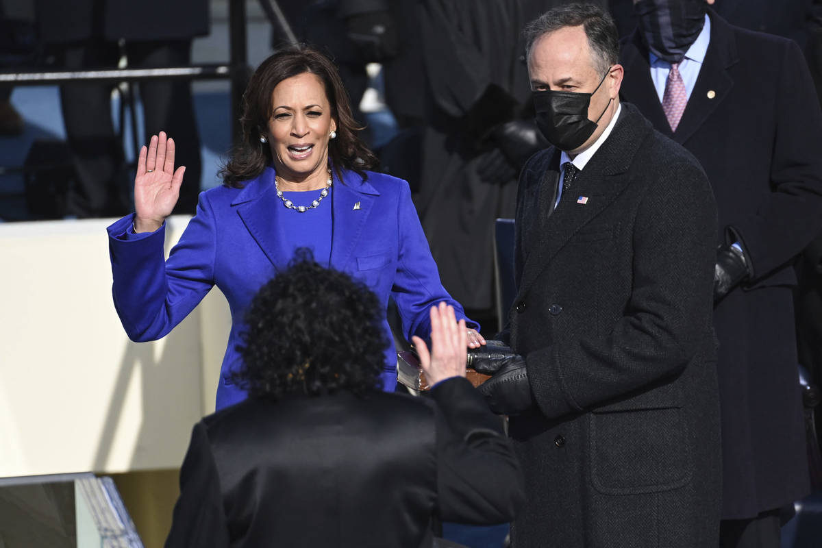 Kamala Harris is sworn in as vice president by Supreme Court Justice Sonia Sotomayor as her hus ...