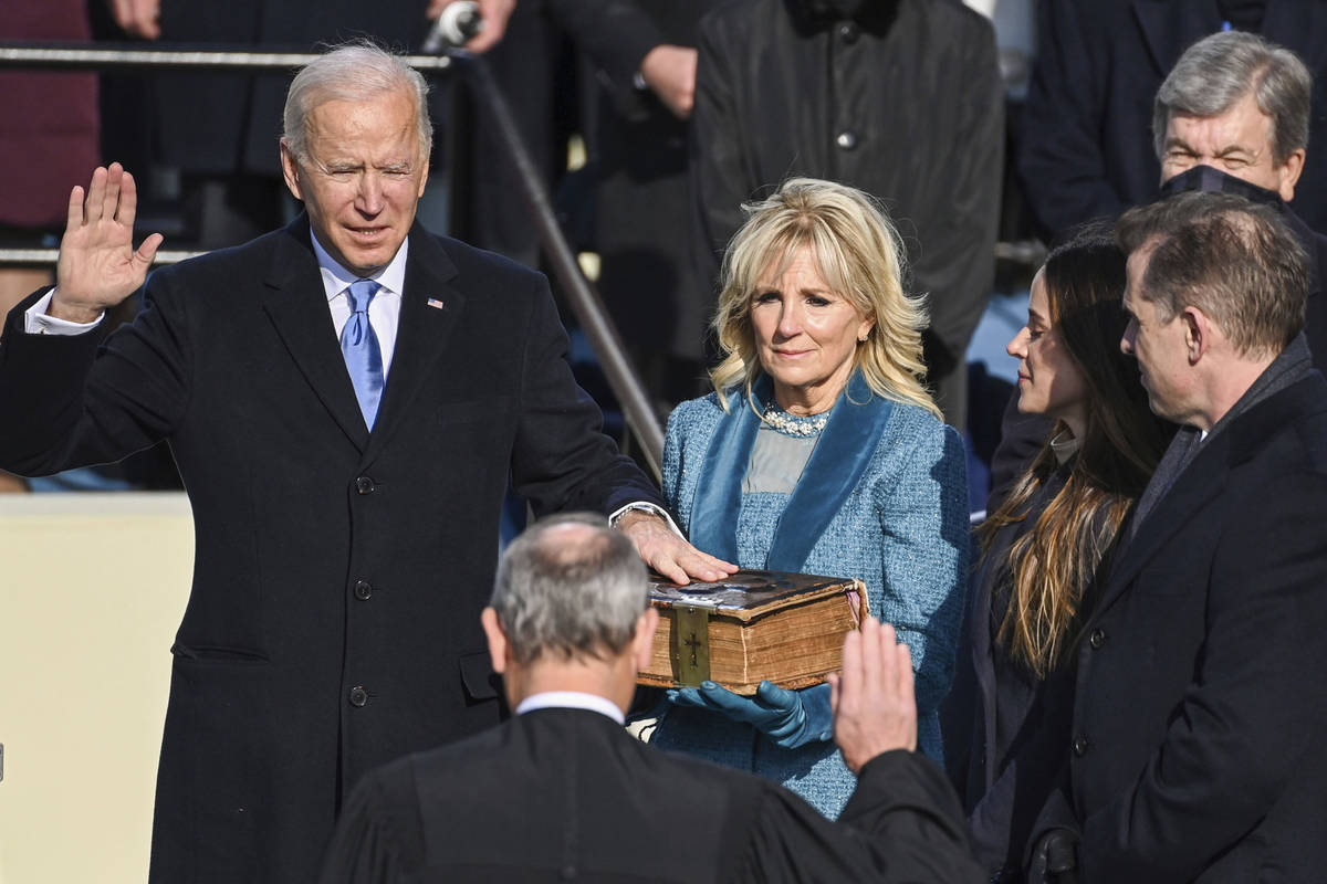 Joe Biden is sworn in as the 46th president of the United States by Chief Justice John Roberts ...