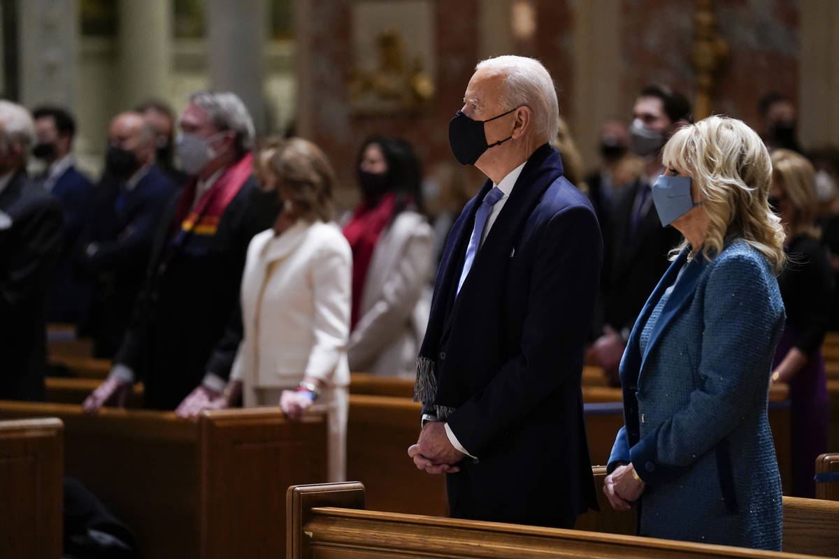 President-elect Joe Biden and his wife Jill Biden attend Mass at the Cathedral of St. Matthew t ...