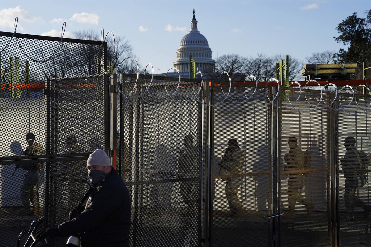 National Guards walk to the Capitol Building as events get underway for President-elect Joe Bid ...