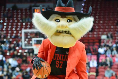 Hey Reb! dribbles the ball before the UNLV Rebels and the New Mexico Lobos NCAA basketball game ...