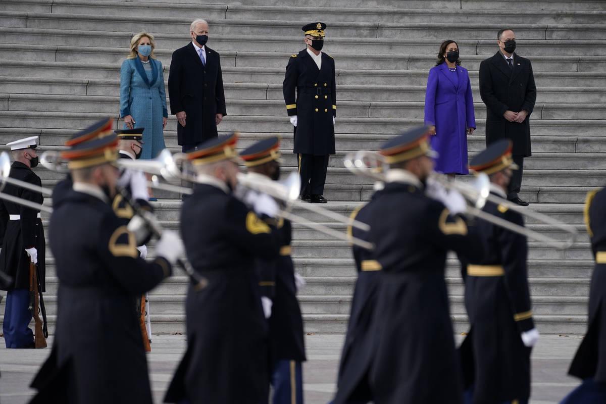 From left, first lady Jill Biden, President Joe Biden, Vice President Kamala Harris and her hus ...