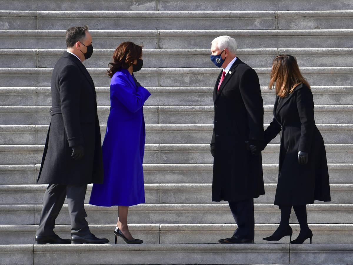 Vice President Kamala Harris and husband Douglas Emhoff exchange words with former Vice Preside ...