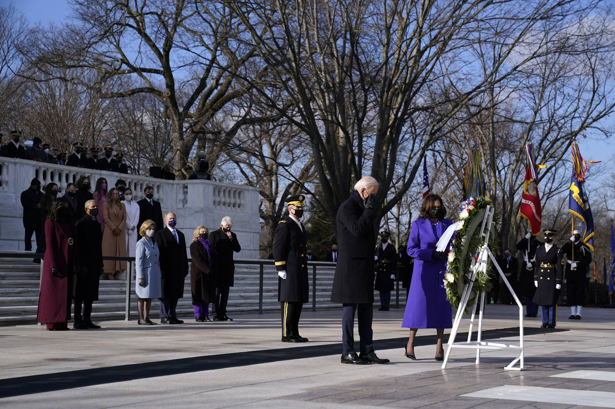 President Joe Biden and Vice President Kamala Harris participate in a wreath laying ceremony at ...