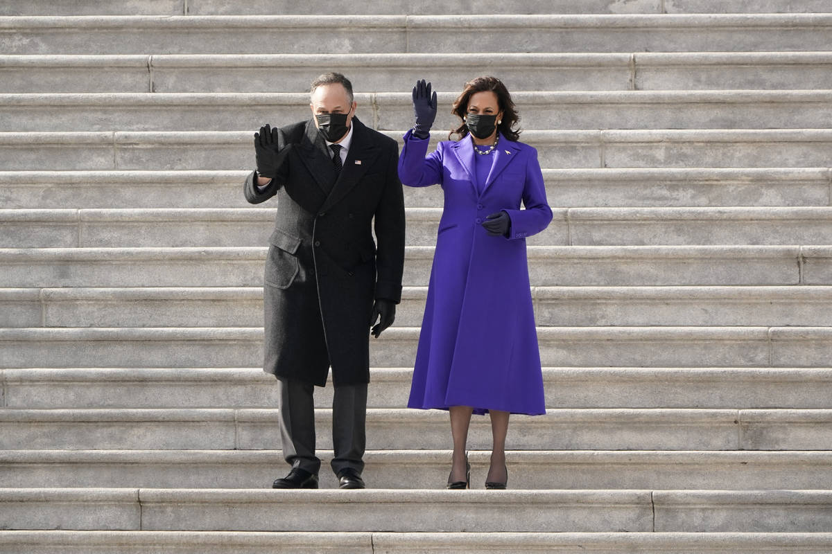Vice President Kamala Harris and her husband Doug Emhoff wave as former Vice President Mike Pen ...