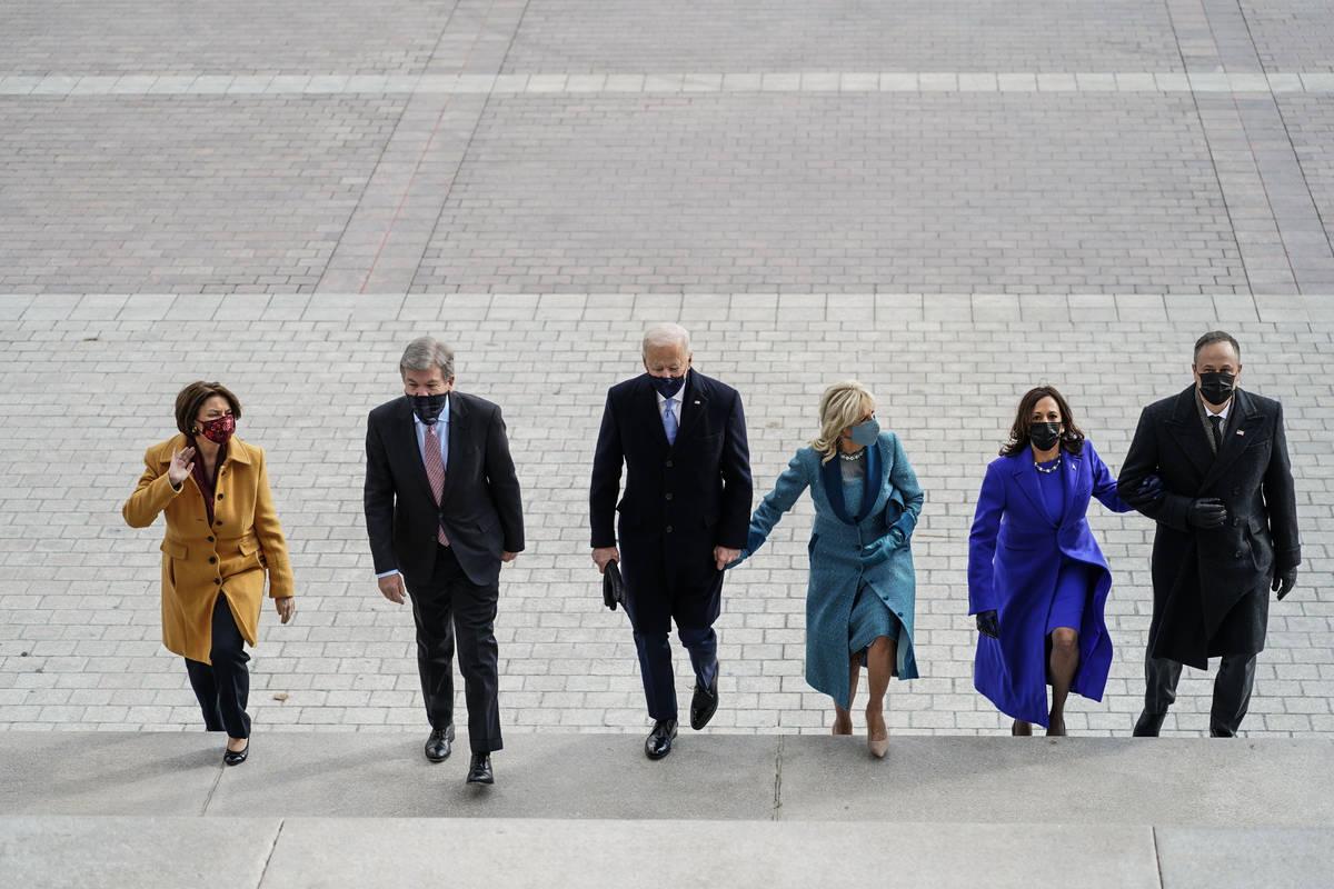 From left, Amy Klobuchar, D-Minn., Sen. Roy Blunt, R-Mo., President-elect Joe Biden, Jill Biden ...