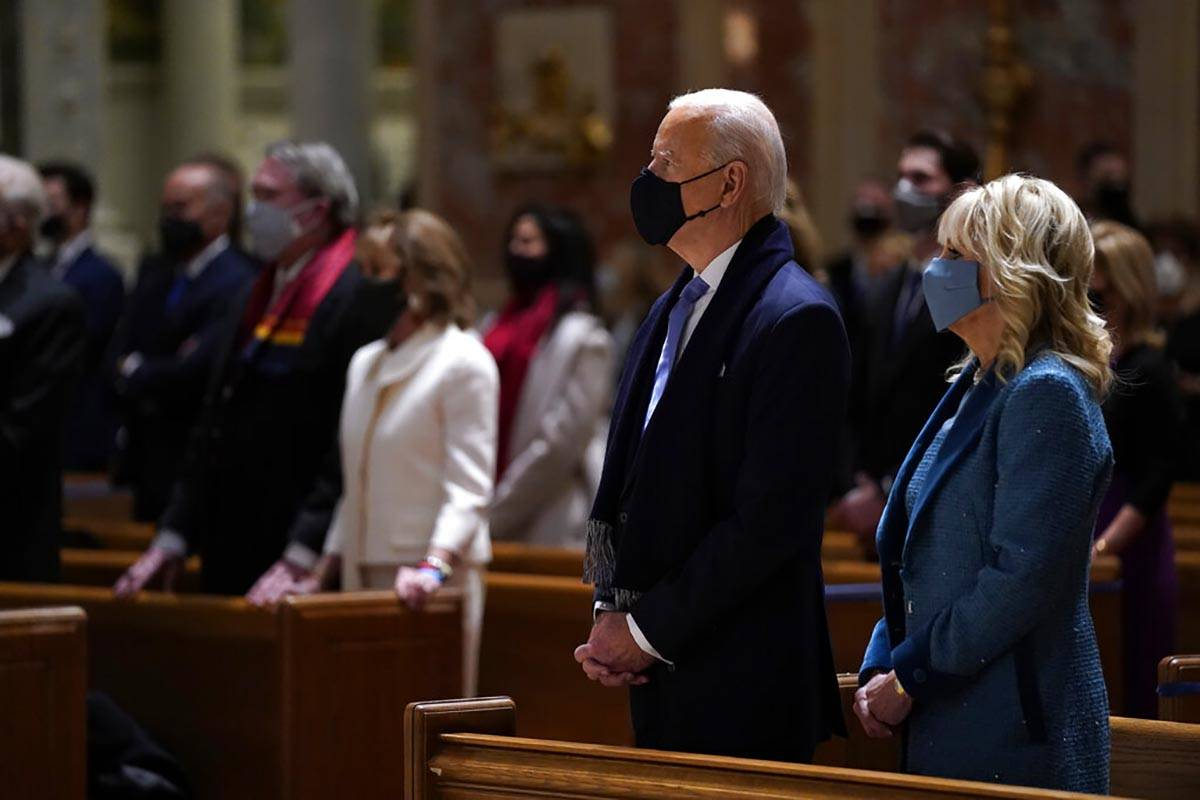 President-elect Joe Biden is joined his wife Jill Biden as they celebrate Mass at the Cathedral ...