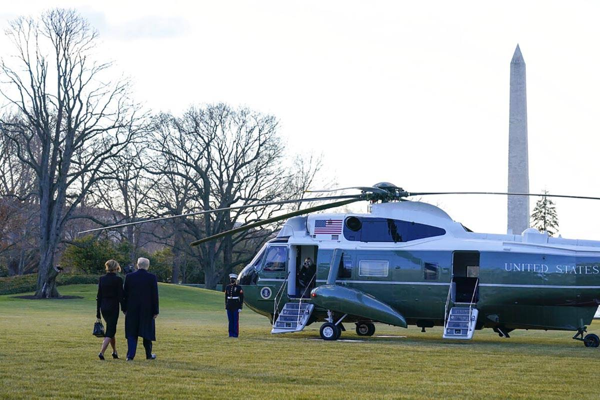 President Donald Trump and first lady Melania Trump walk to board Marine One on the South Lawn ...