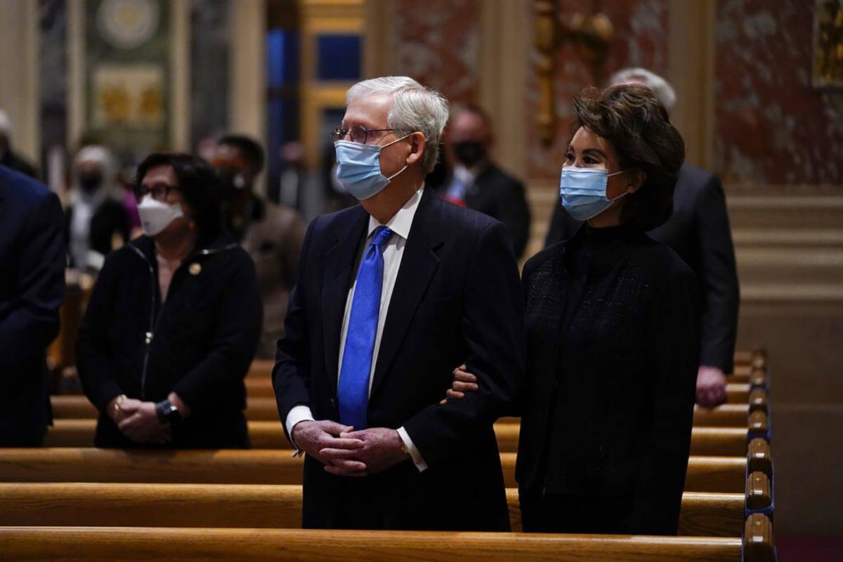Senate Minority Leader Mitch McConnell and his wife, Elaine Chao, attend Mass at the Cathedral ...