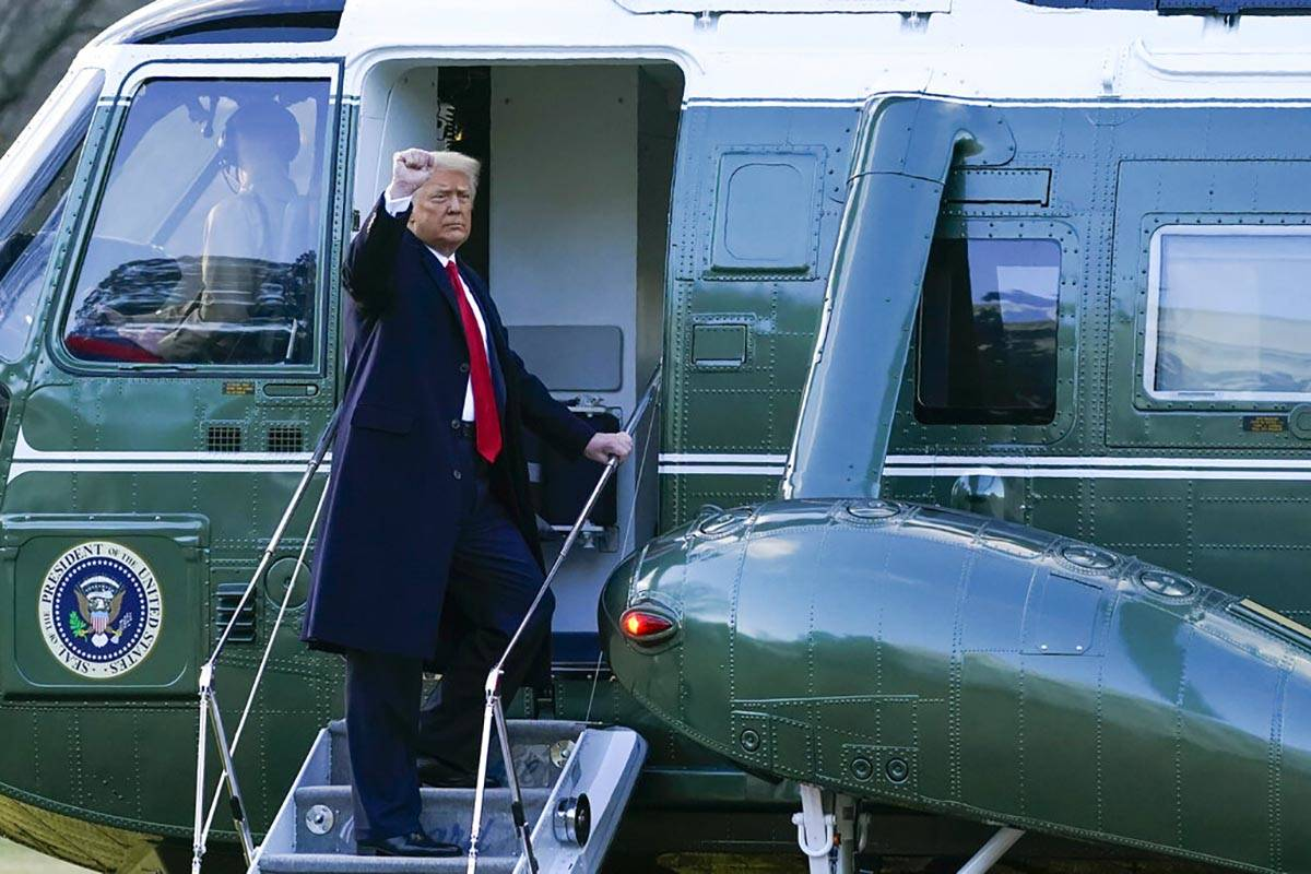 President Donald Trump gestures as he boards Marine One on the South Lawn of the White House, W ...