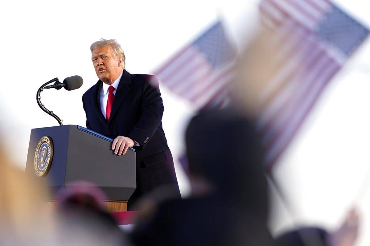 President Donald Trump speaks before boarding Air Force One at Andrews Air Force Base, Md., Wed ...