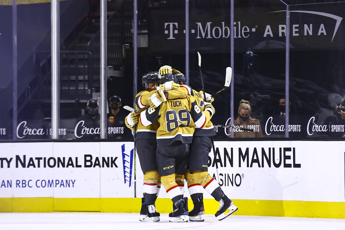 Golden Knights defenseman Alex Pietrangelo, right, celebrates his goal with teammates during th ...