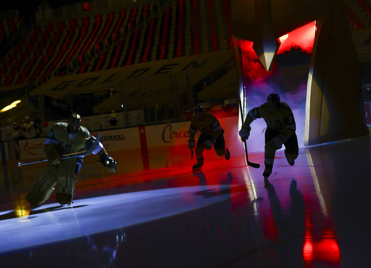 The Golden Knights warm up before taking on the Arizona Coyotes in an NHL hockey game at T-Mobi ...