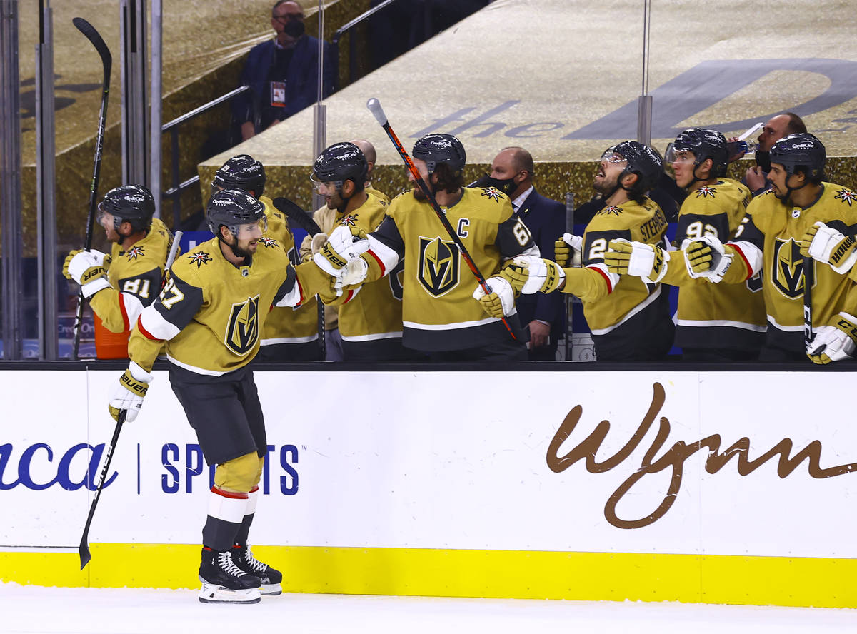 Golden Knights defenseman Shea Theodore (27) celebrates his goal with teammates during the firs ...