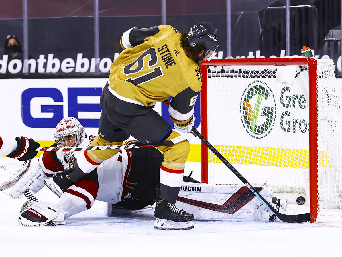 Golden Knights right wing Mark Stone (61) gets the puck past Arizona Coyotes goaltender Darcy K ...