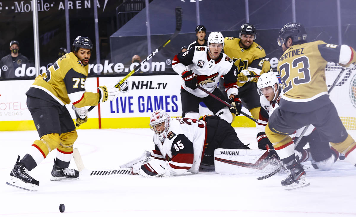 Golden Knights right wing Ryan Reaves (75) eyes the puck after a block by Arizona Coyotes goalt ...