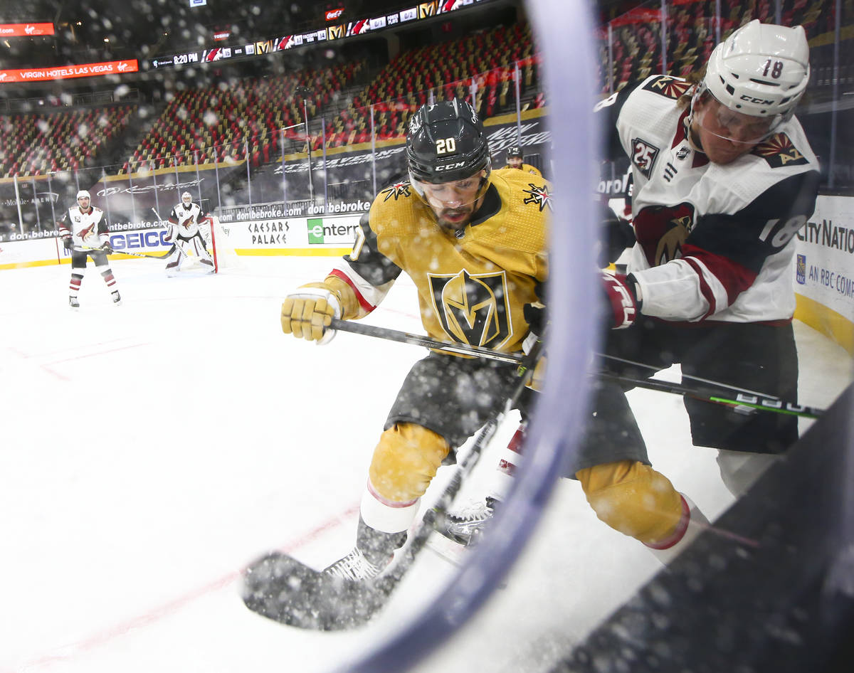 Golden Knights center Chandler Stephenson (20) and Arizona Coyotes center Christian Dvorak (18) ...