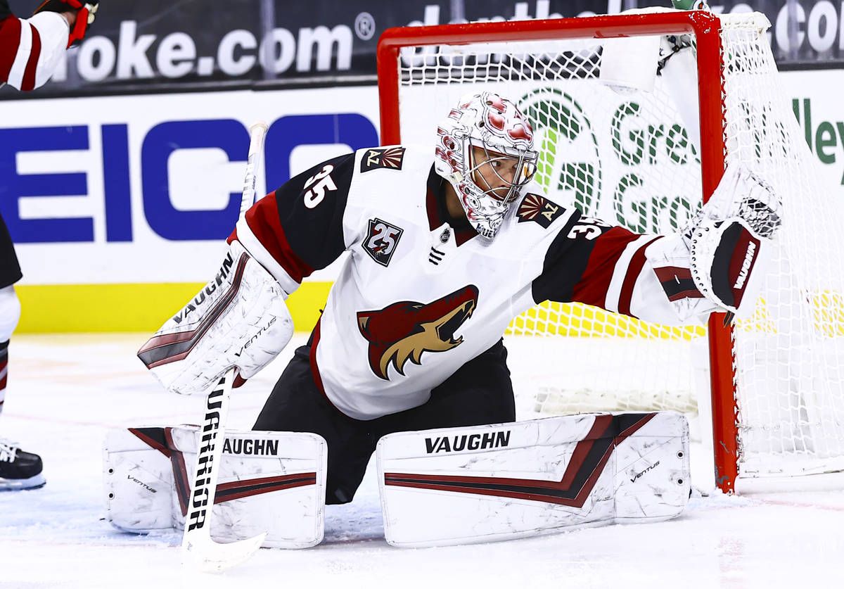 Arizona Coyotes goaltender Darcy Kuemper (35) makes a save against the Golden Knights during th ...