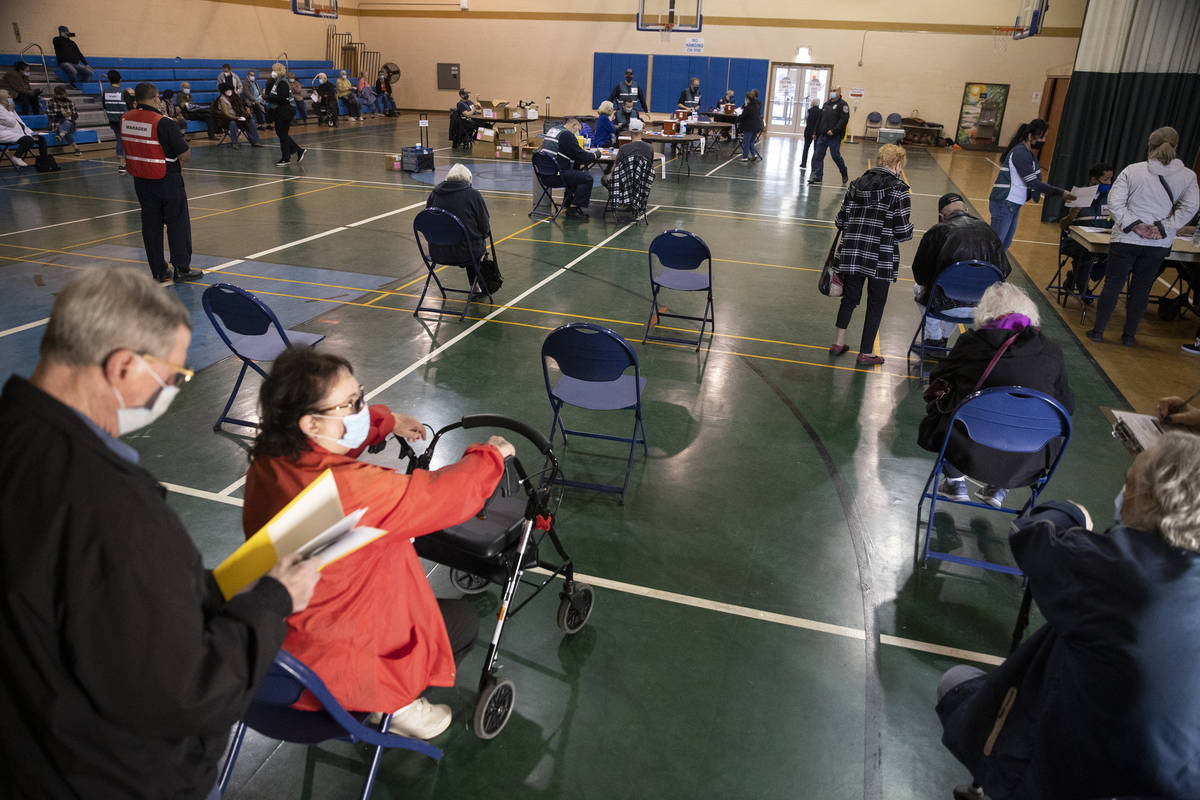 People wait to receive the COVID-19 vaccine at the Neighborhood Recreation Center in North Las ...