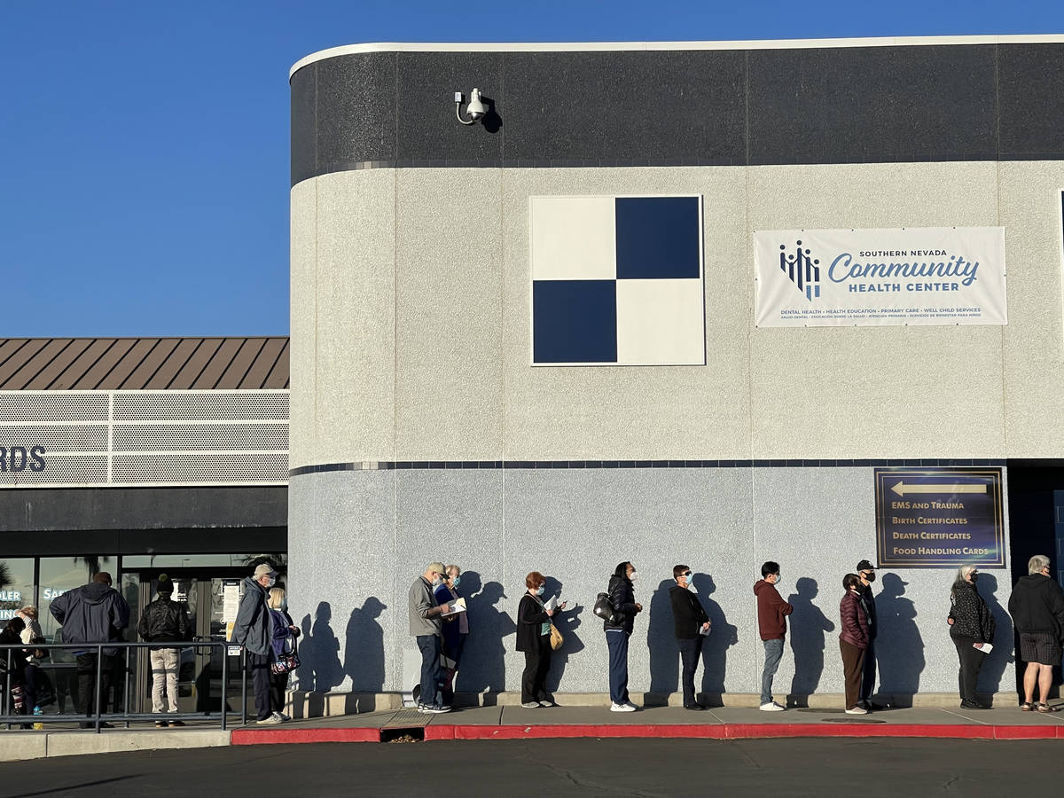 People line up for COVID-19 vaccinations at the Southern Nevada Health District in Las Vegas Th ...