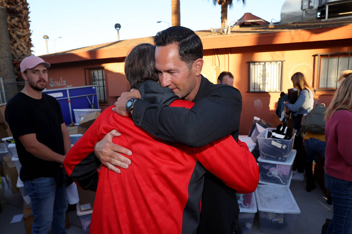 Kyle Kimoto, right, hugs foundation co-founder Ryan Wolfington at Jewel's Marty Hennessy Inspir ...
