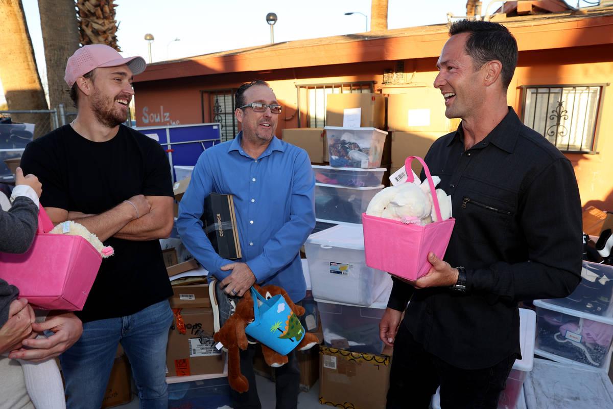 Kyle Kimoto, right, visits with Steven Berkabile, the husband of his ex-wife Juliette Berkabile ...