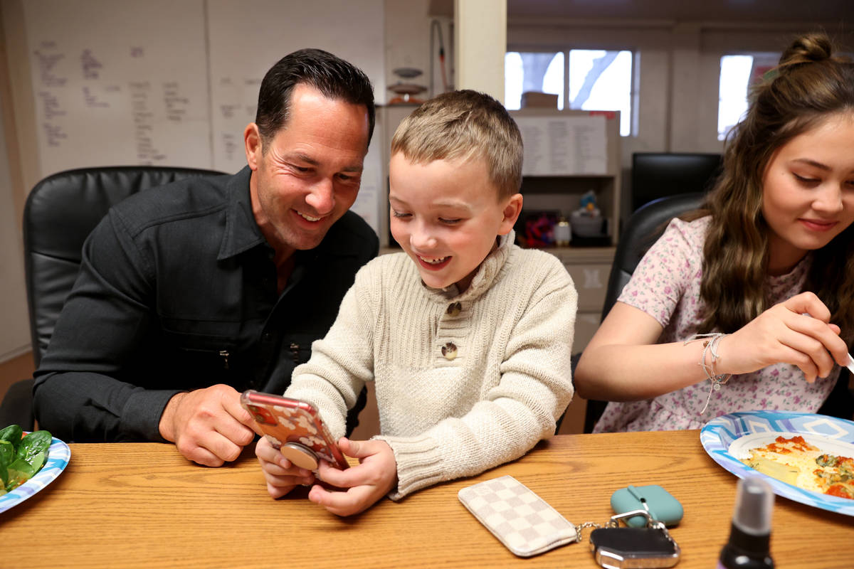 Kyle Kimoto does a video call with Beau Berkabile, 6, son of his ex-wife Juliette Berkabile, at ...