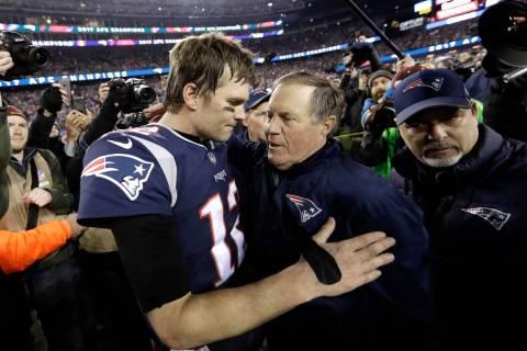 In this Jan. 21, 2018, file photo, New England Patriots quarterback Tom Brady, left, hugs coach ...