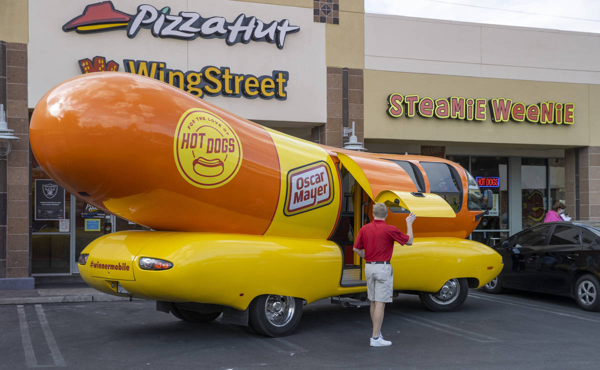 Tommy Salami exits the Oscar Mayer Wienermobile just parked outside the Steamie Weenie on Frida ...