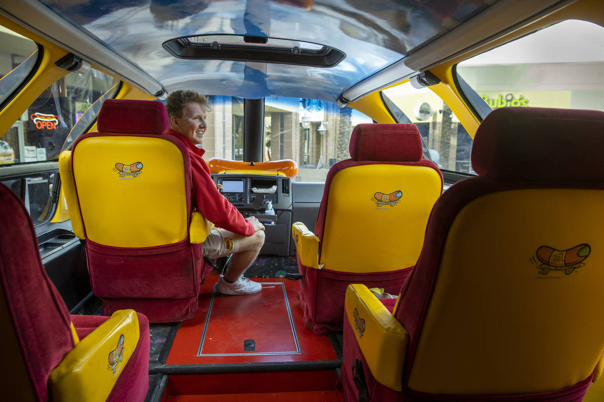 Tommy Salami sits behind the wheel as part of a two-person crew with the Oscar Mayer Wienermobi ...