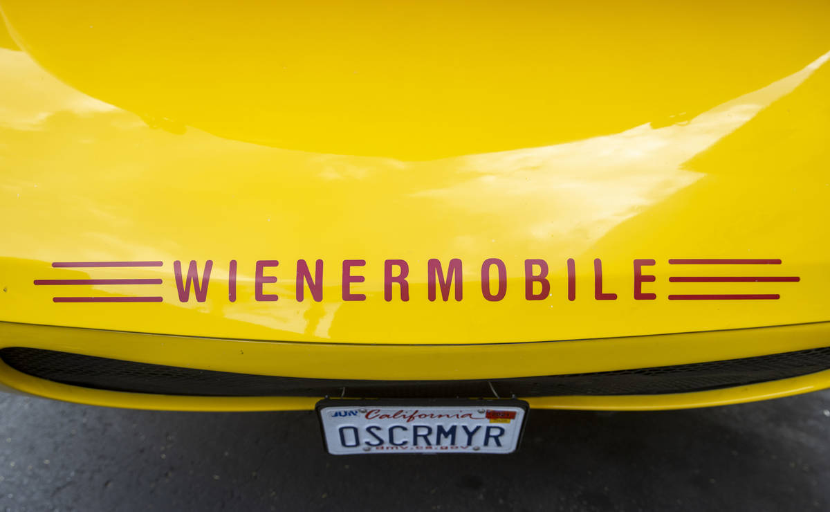 The custom wording on the bumper of the Oscar Mayer Wienermobile parked outside the Steamie Wee ...