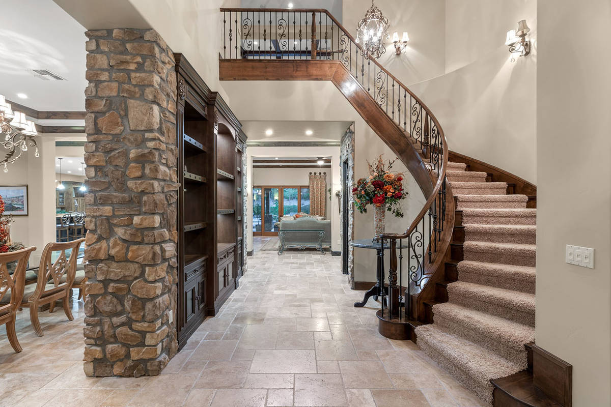 Upstairs, an additional family room has an expansive balcony overlooking the backyard and there ...