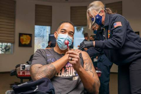 North Las Vegas fire fighter Mike Rodgers, 31, receives a lollipop after receiving a COVID-19 v ...