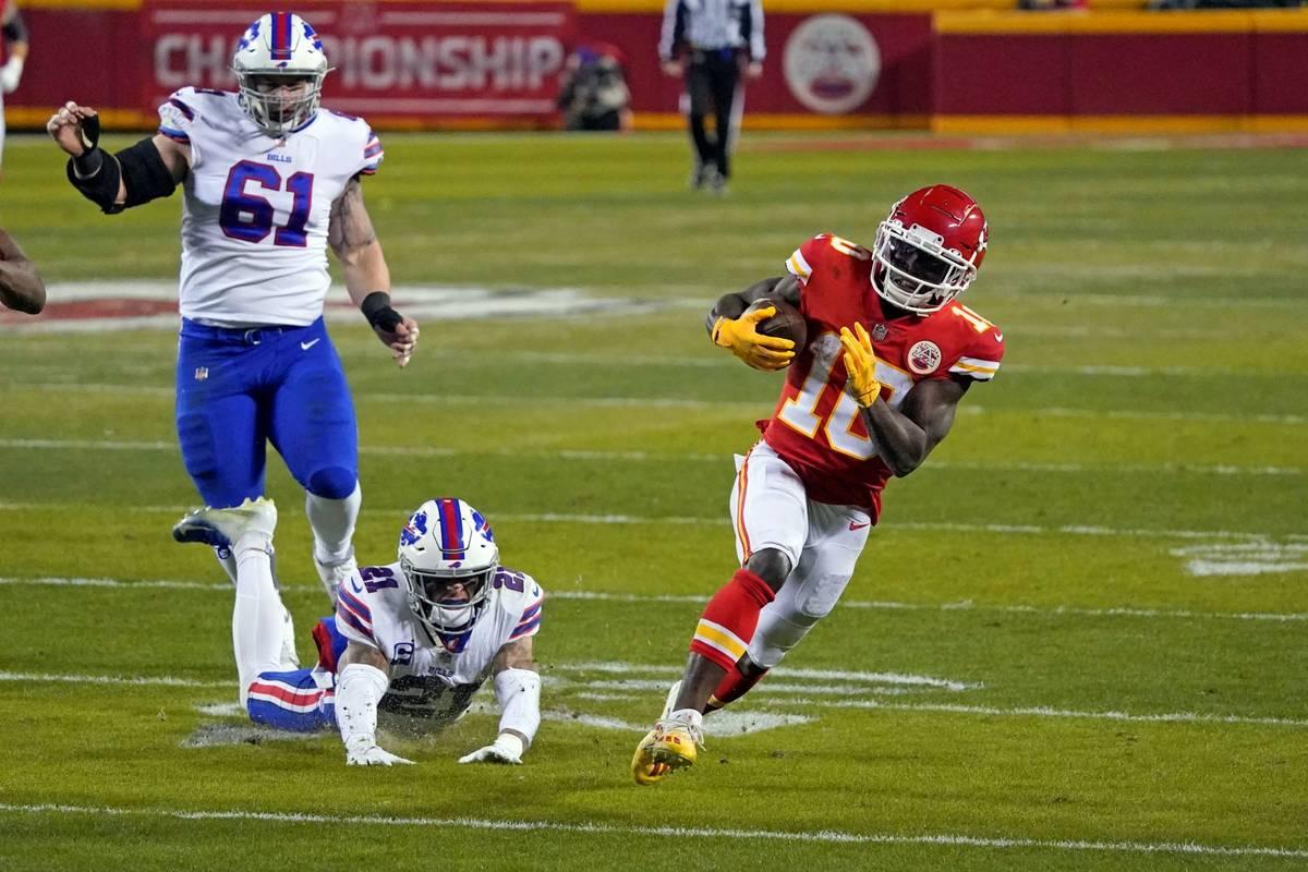 Kansas City Chiefs wide receiver Tyreek Hill (10) runs from Buffalo Bills safety Jordan Poyer ( ...