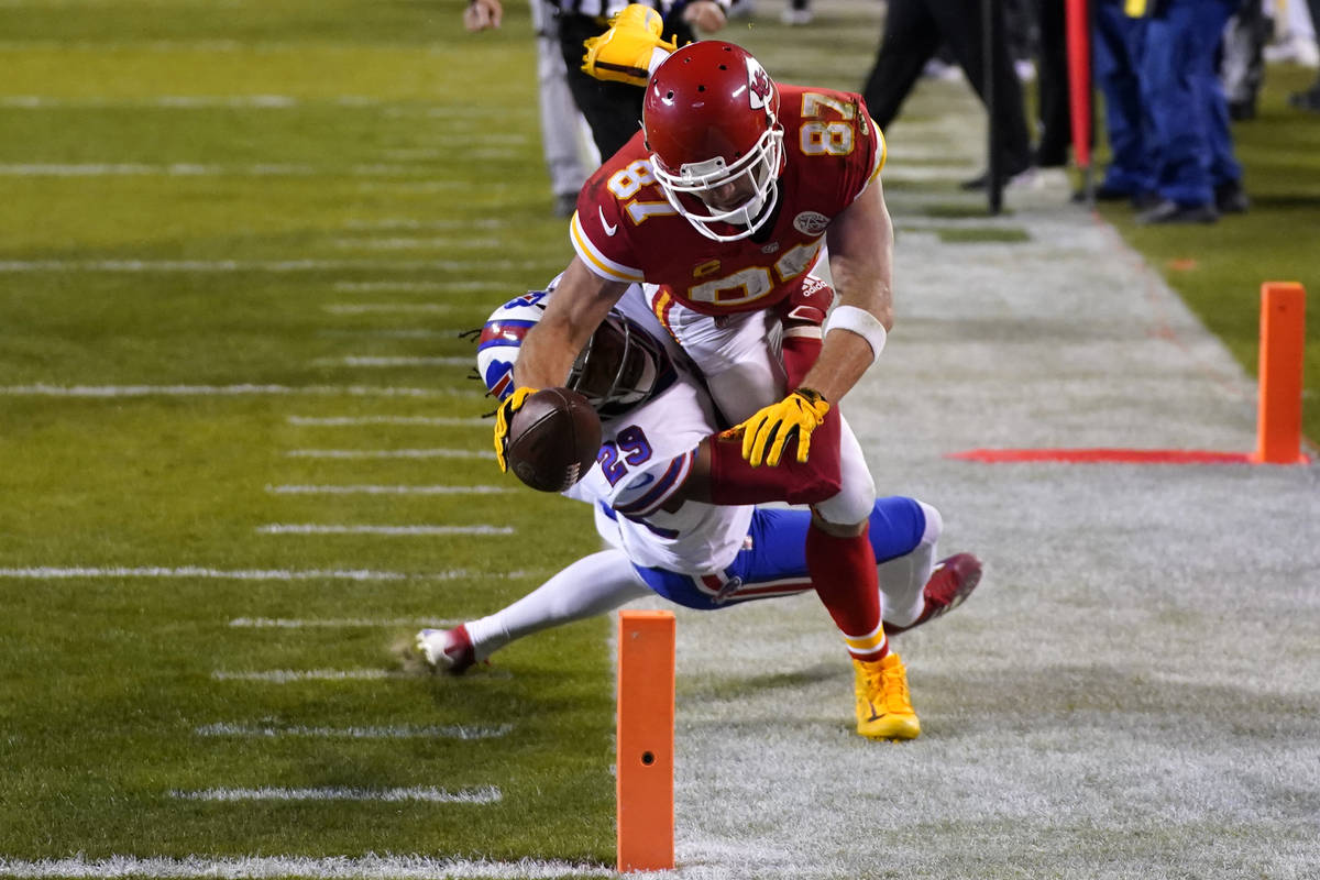 Kansas City Chiefs tight end Travis Kelce (87) dives toward the goal line over Buffalo Bills co ...