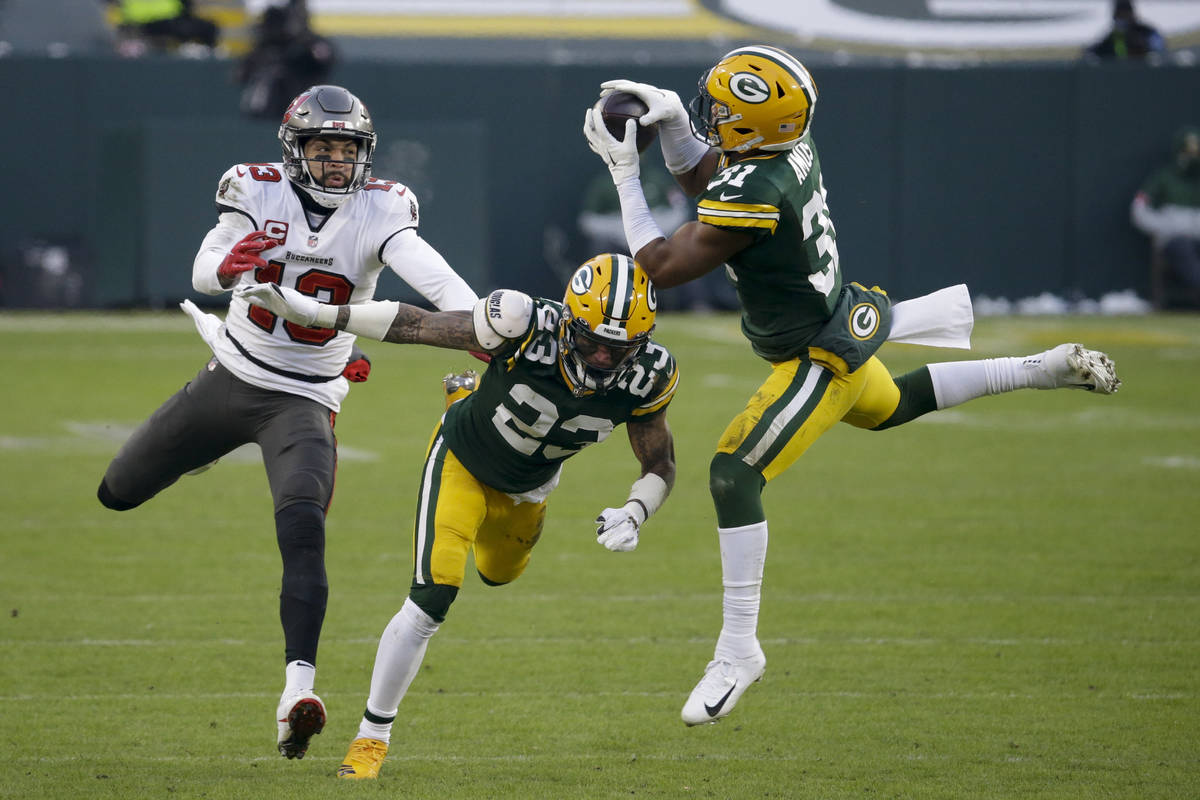 Green Bay Packers' Adrian Amos (31) intercepts a pass intended for Tampa Bay Buccaneers' Mike E ...