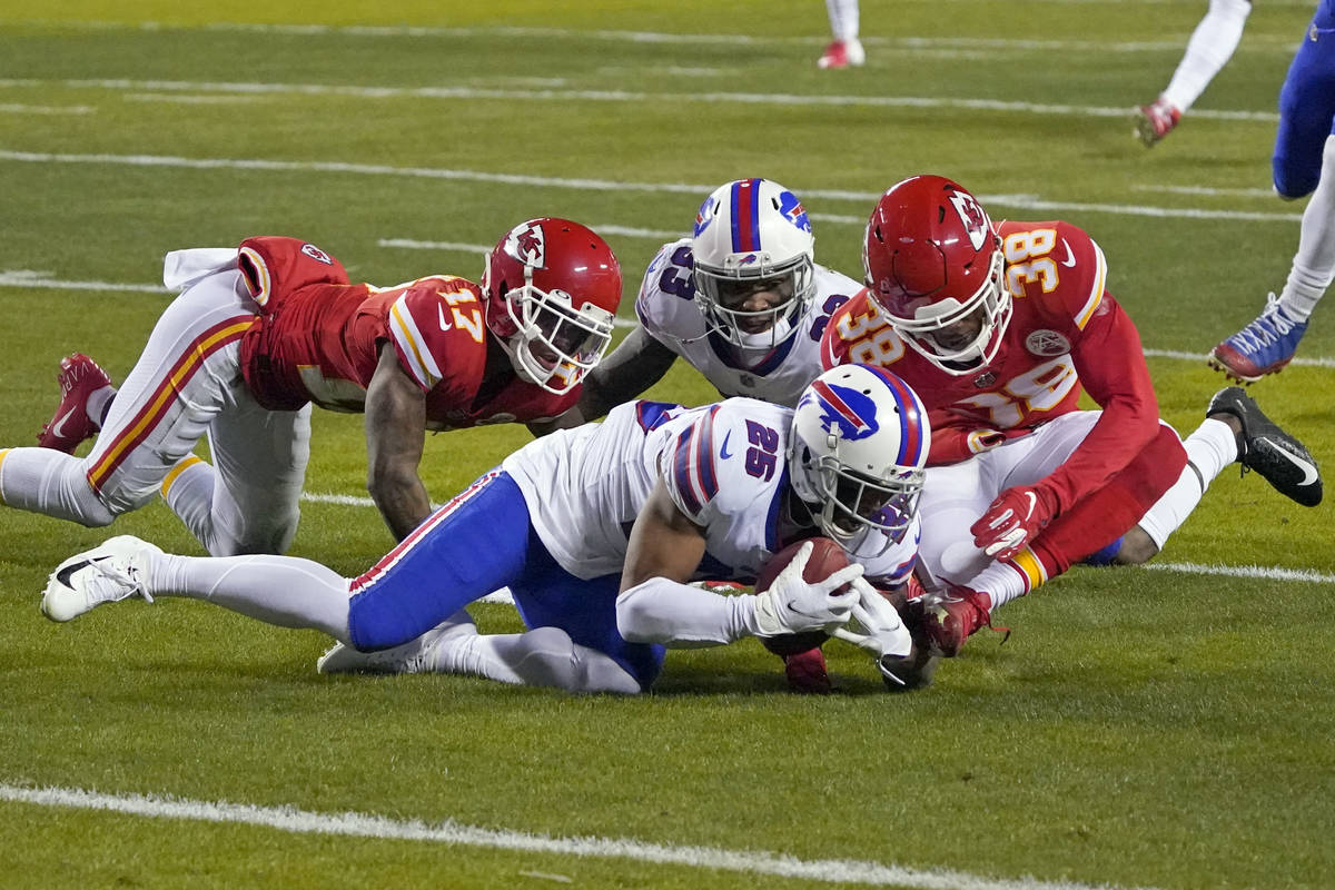 Buffalo Bills running back Taiwan Jones (25) recovers a fumble ahead of Kansas City Chiefs safe ...