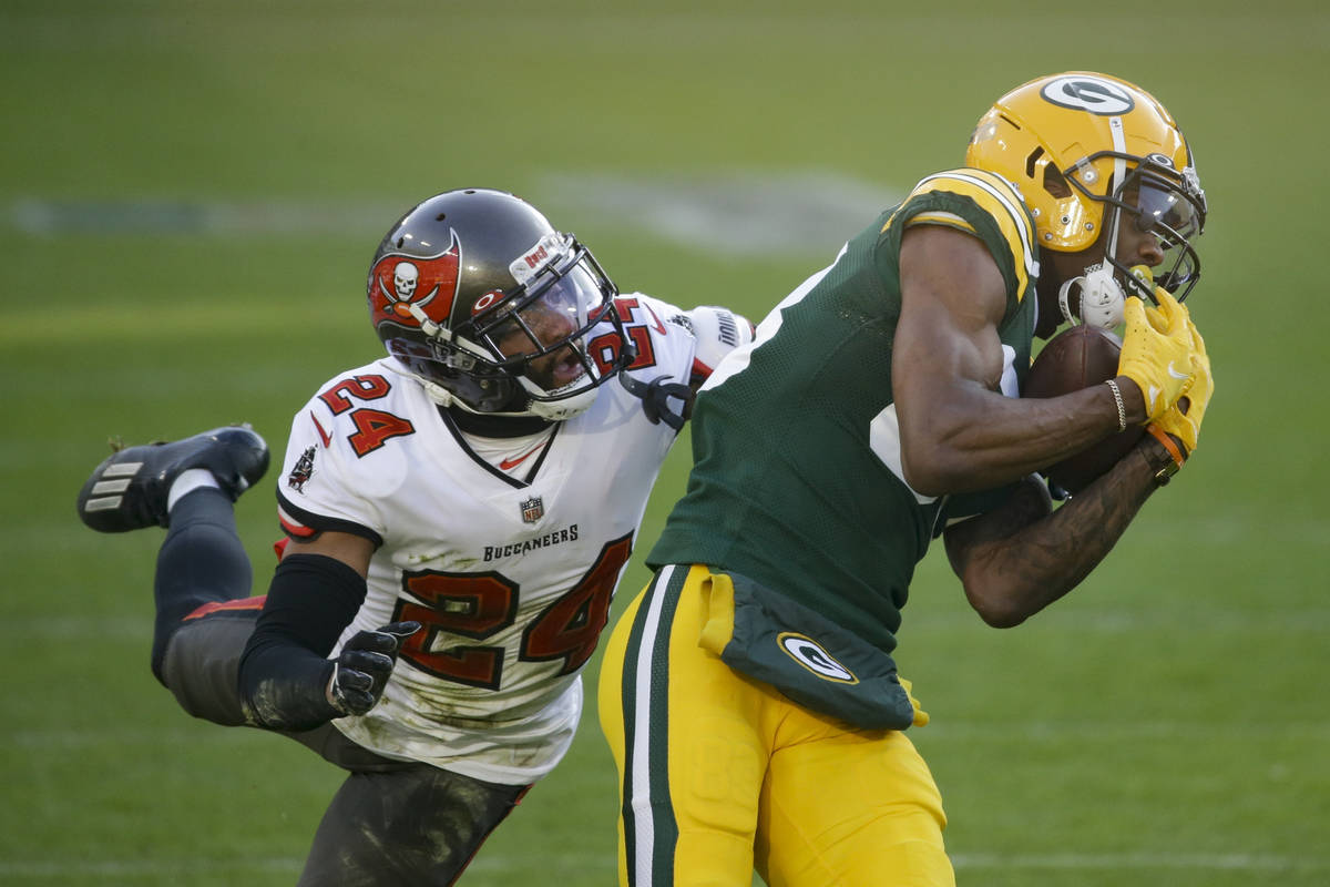 Green Bay Packers' Marquez Valdes-Scantling pulls in a 50-yard touchdown pass against Tampa Bay ...