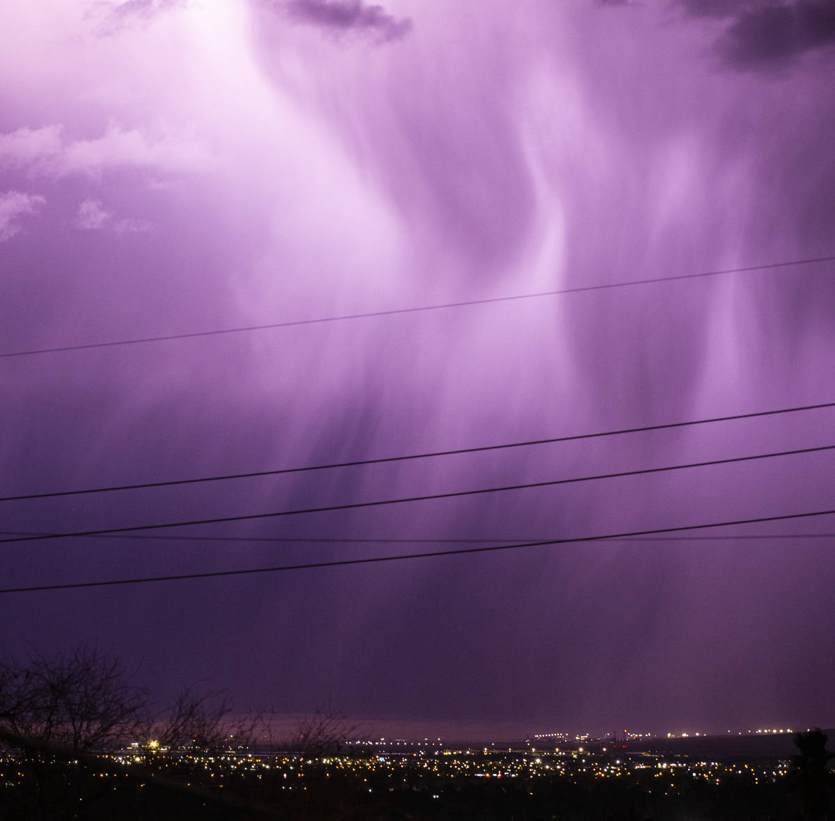 Lightning lights up the sky as rain comes down in east Las Vegas on Friday, Jan. 22, 2021. (Cha ...