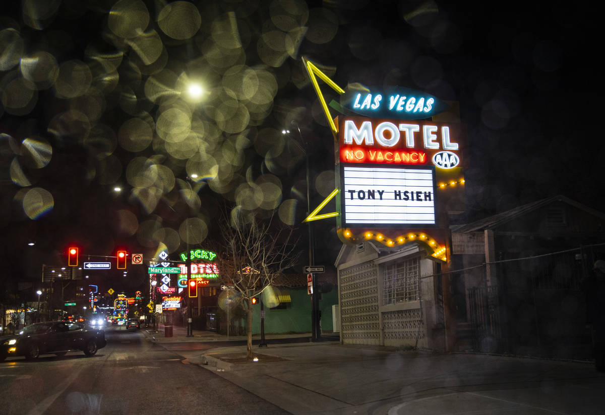 The restored Las Vegas Motel sign is seen through raindrops on Fremont Street in downtown Las V ...