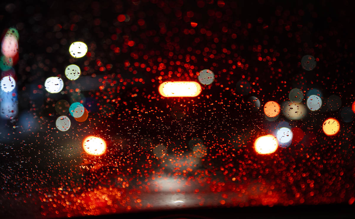 Raindrops are seen on a windshield in Las Vegas on Friday, Jan. 22, 2021. (Chase Stevens/Las Ve ...