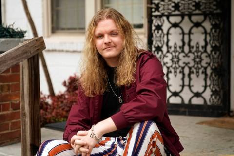 Jesse Robinson sits on his porch, Thursday, Jan. 21, 2021, in Nashville, Tenn. Robinson has rec ...