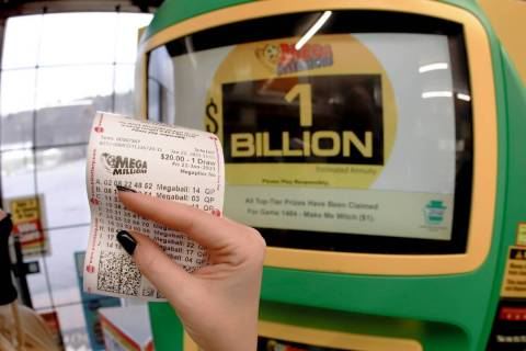 A patron, who did not want to give her name, shows the ticket she had just bought for the Mega ...