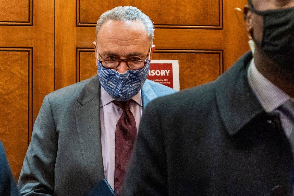 Senate Majority Leader Chuck Schumer of N.Y, takes the elevator in the U.S. Capitol , Friday, J ...