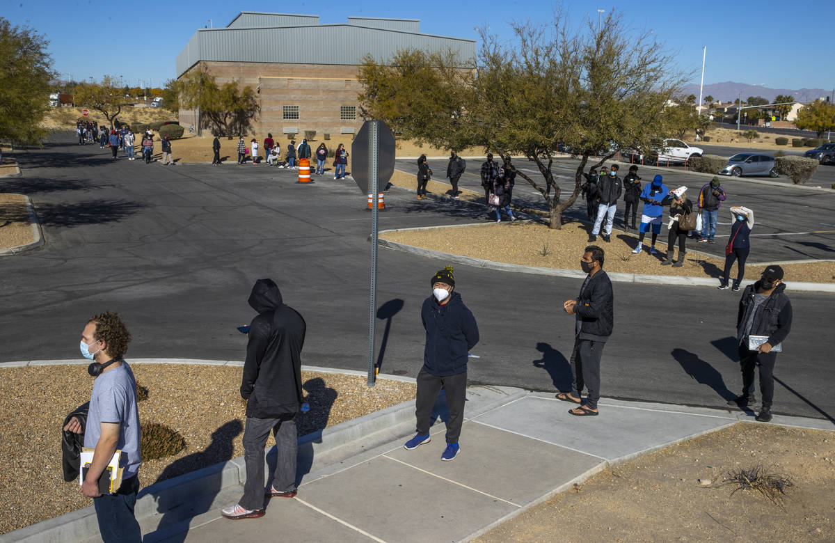 Long lines of people form regularly around the parking lot outside the Nevada Department of Mot ...