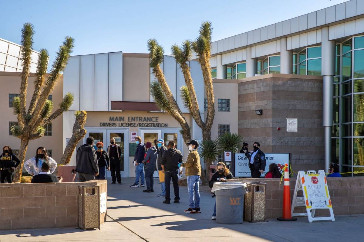 Long lines of people form regularly outside the Nevada Department of Motor Vehicles on West. Fl ...