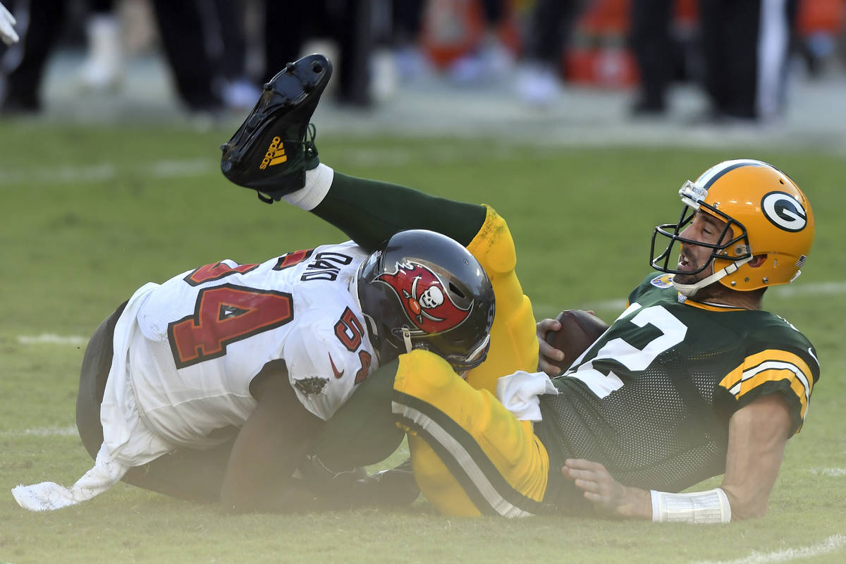 Green Bay Packers quarterback Aaron Rodgers (12) gets sacked by Tampa Bay Buccaneers inside lin ...