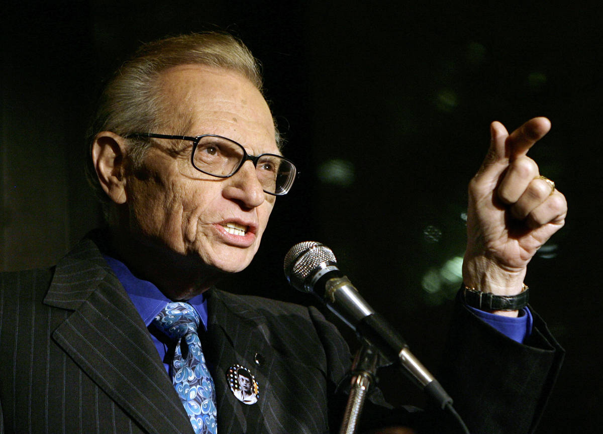 FILE - In this April 18, 2007 file photo, Larry King speaks to guests at a party held by CNN, c ...